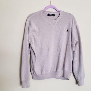 A tan Polo sweater
